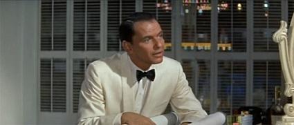 Manetta (interpretado por Sinatra), seducido por una economía especulativa que pierde el genuino sentido de las finanzas