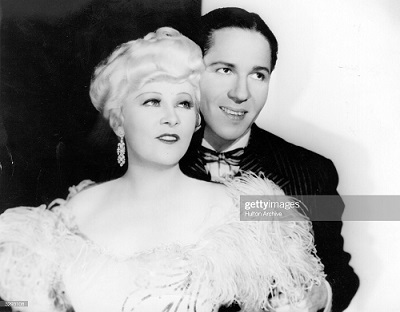 1934: Mae West (1892 - 1980) and Roger Pryor (1901 - 1974) star in the Paramount film 'Belle Of The Nineties', directed by Leo McCarey. (Photo by Hulton Archive/Getty Images)